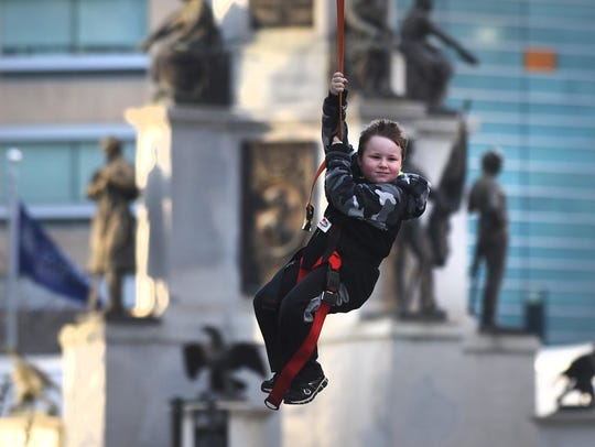 Brayden Temple, 6, of Canton, enjoys the zip line during