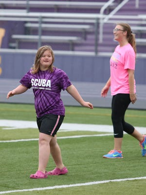 Katie Ball, left, a senior at Waukee High School, practices with classmates for the upcoming Powder Puff football game, which is part of 2014 homecoming activities at Waukee. Ball was nominated for homecoming queen by her classmates.