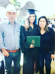 Juana Rivas Hernandez, right, and Angel Hernandez, left, with their daughter, Daisy Hernandez, the day of her graduation from Florida Gulf Coast University. Daisy Hernandez graduated with a bachelor's degree in criminal justice.