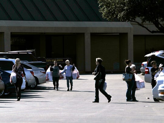 Shoppers leave JC Penney at the Mall of Abilene on Black Friday in 2017.