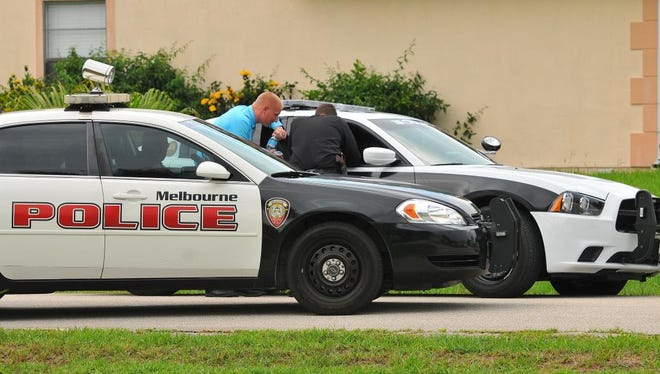 The Melbourne and Palm Bay police departments search for armed robbery suspects Thursday afternoon near London Lane in Palm Bay .