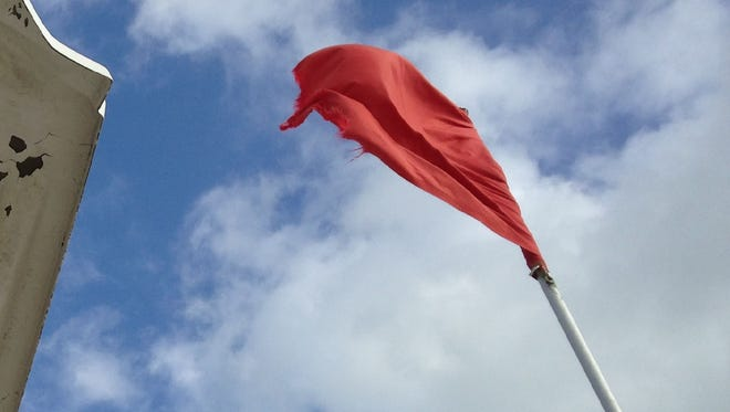 A red hazard flag flies at an Indian River County beach.