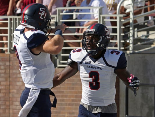 Samford wide receiver Karel Hamilton (3) celebrates a passing touchdown with quarterback Devlin Hodges (8) during the first half of their NCAA college football game against Mississippi State in Starkville, Miss., Saturday, Oct. 29, 2016. (AP Photo/Jim Lytle)