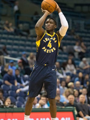 Oct 4, 2017; Milwaukee, WI, USA; Indiana Pacers guard Victor Oladipo (4) shoots during the first quarter against the Milwaukee Bucks at BMO Harris Bradley Center.