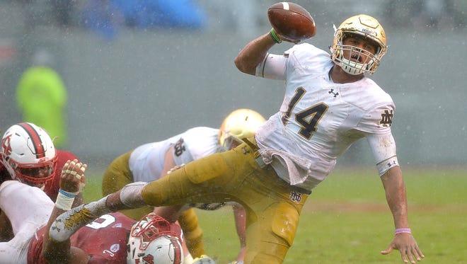 Bradley Chubb of North Carolina State trips up Notre Dame QB DeShone Kizer.