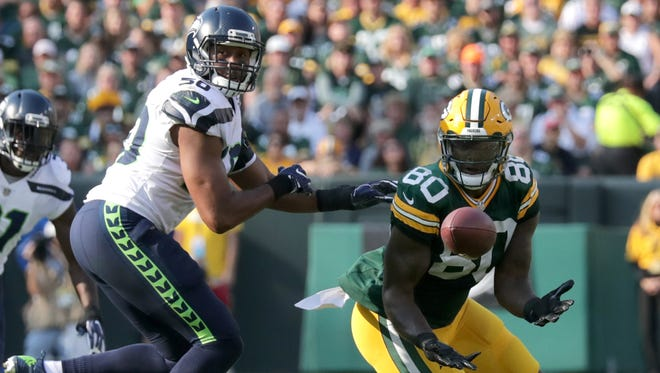 Green Bay Packers tight end Martellus Bennett (80) catches a first-quarter pass against the Seattle Seahawks on Sunday, Sept. 10, 2017, at Lambeau Field.