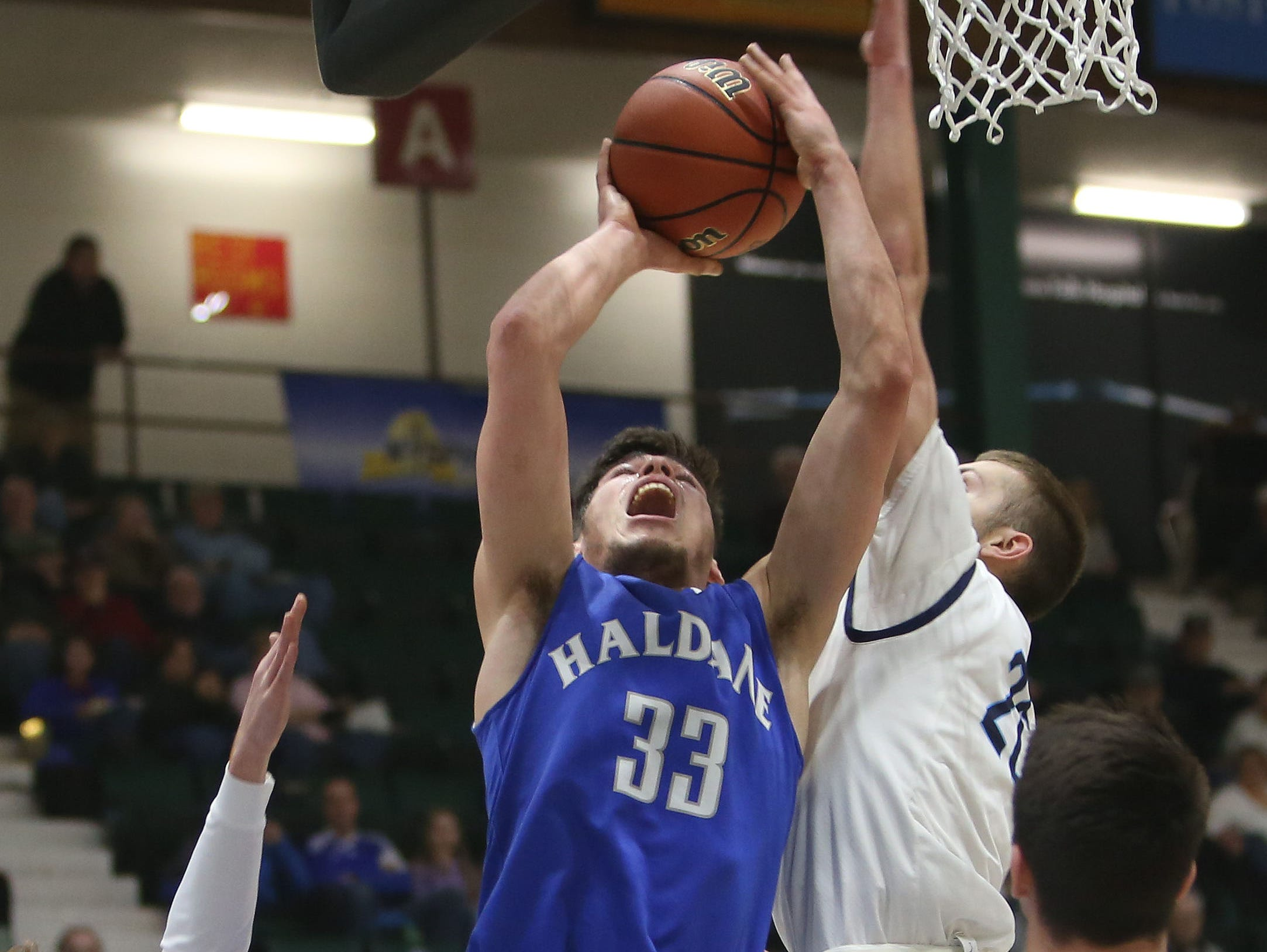 Haldane's Will Zuvic (33) drives to the basket against Moravia during the boys Class C semifinal at the Glens Falls Civic Center March 11, 2016. Haldane won the game 36-34.