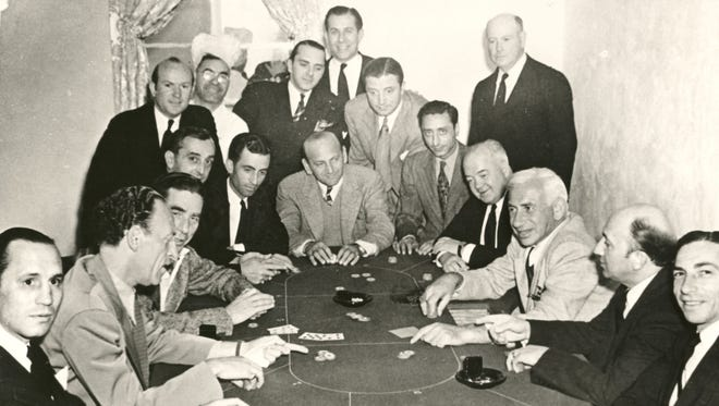 Gamblers at The Dunes Club in Cathedral City circa 1940. Al Wertheimer, a member of Detroit's Purple Gang, is seated third from front left.