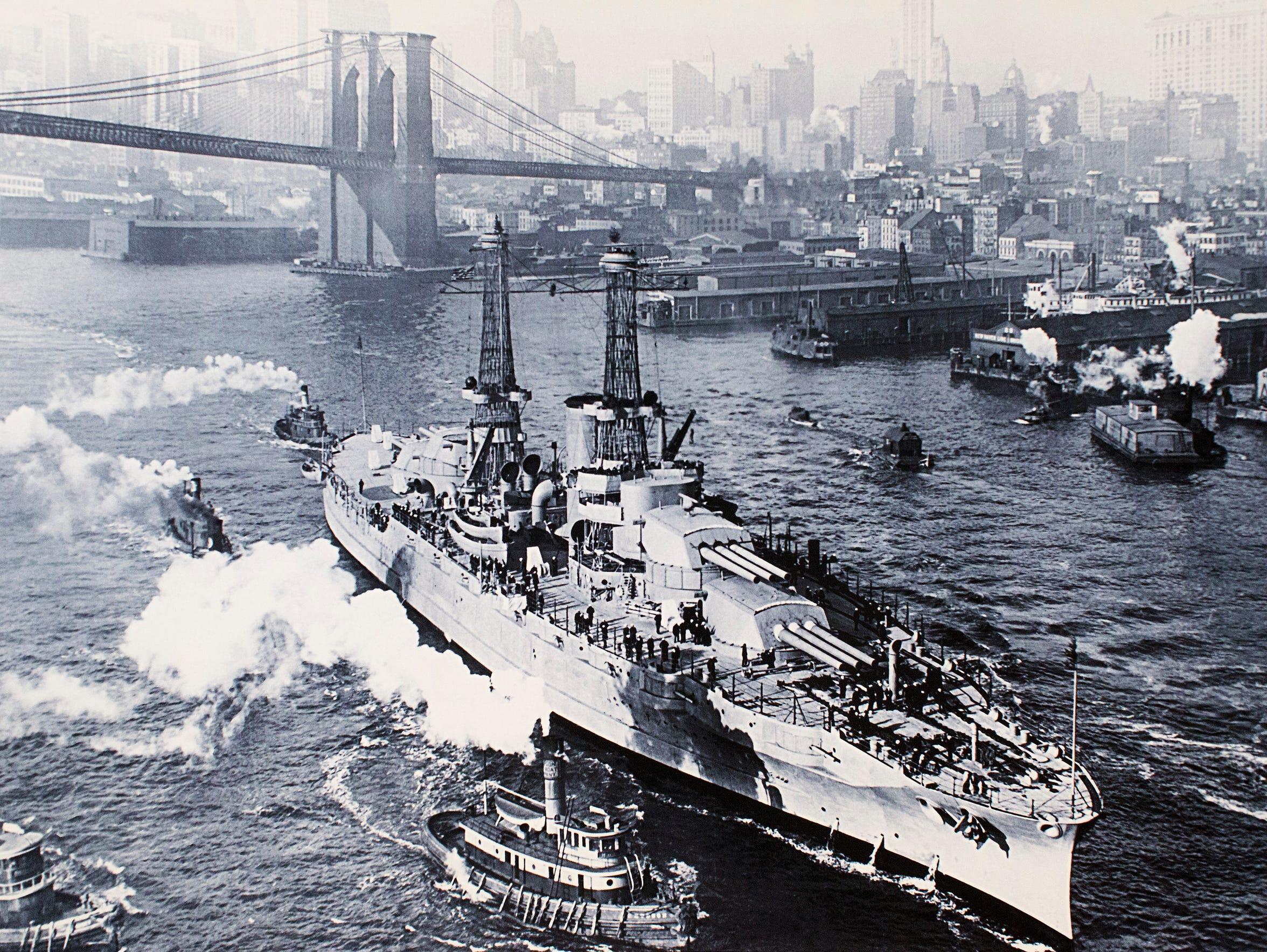 The New York City skyline and the Brooklyn Bridge can