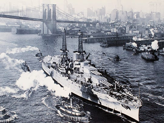 The New York City skyline and the Brooklyn Bridge can be seen behind the USS Arizona as the ship leaves New York to help escort President Wilson to the Paris Peace Conference in December of 1918 at the end of World War I. Although the Arizona first went under way two years earlier, it never fought in the war.