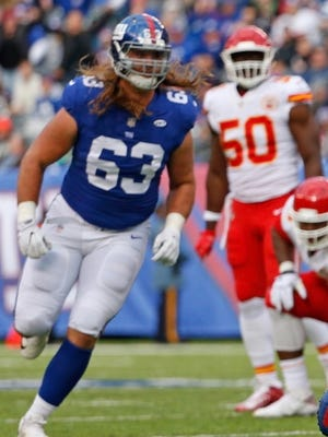 Does New York Giants lineman Chad Wheeler have the inside track to start at right tackle with Ereck Flowers still not participating in the team's offseason program and no tackles having been added to the roster in the draft?