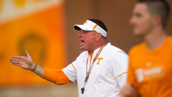 Tennessee Head Coach Butch Jones yells on the field during a University of Tennessee fall football practice at Anderson Training Facility in Knoxville, Tenn. on Tuesday, Aug. 1, 2017.