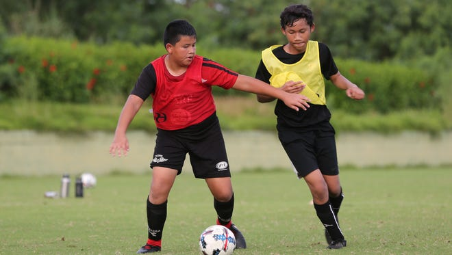 Wings FC's Aaron Bejado keeps possession of the ball as he looks for passing options during the recently concluded Wings FC 4th Annual Summer Clinic and Japan Off Island Competition Saturday at LeoPalace Resort Guam. Bejado is one of nine youth players who will be traveling to Japan this week for the Nakaizu Winery Hill Cup Junior Tournament - an 8-vs-8 youth tournament in Shizuoka.