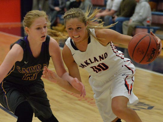 Oakland's Ansley Eubank dribbles past Smyrna's Caitlyn Moore during the Lady Patriots 70-40 rout on Monday night.