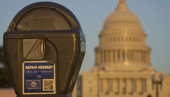 The U.S. Capitol is seen behind a parking meter in Washington, D.C