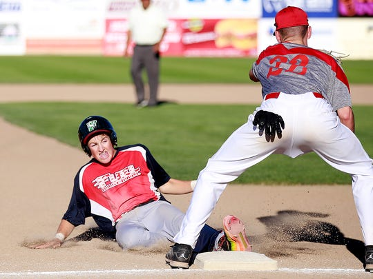 The Fuel's Danny Carpenter slides into third base during a game against 4-Corners on Thursday at Ricketts Park.