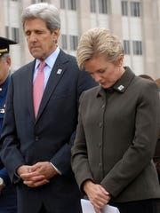 In this 2006 LSJ file photo, then-U.S. Sen. John Kerry, center, and  then-Gov. Jennifer Granholm  bow their heads with police and others during dedication ceremonies in downtown Lansing for the future site of the Michigan Law Enforcement Officers Memorial Monument.