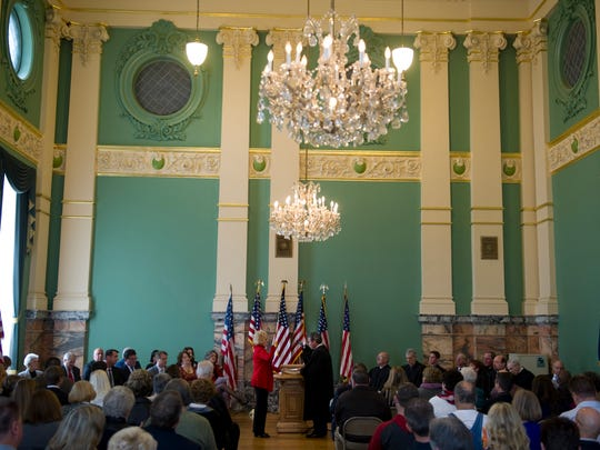 Indiana State Sen. Vaneta Becker is sworn in for another term by Vanderburgh County Superior Court Judge Leslie Shively in the ballroom of the Old Courthouse in Downtown Evansville Sunday afternoon.