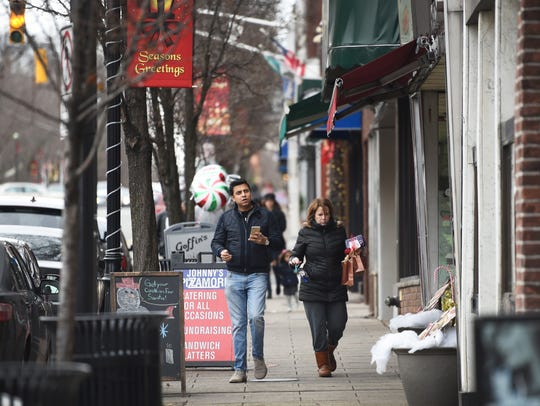 A pair of shoppers strolling on Park Avenue in Rutherford