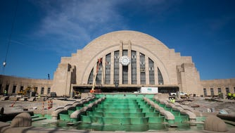 Construction crews work on restoring the Cincinnati Museum Center at Union Terminal Thursday, April 26, 2018. The $212 million project began in the summer of 2016.