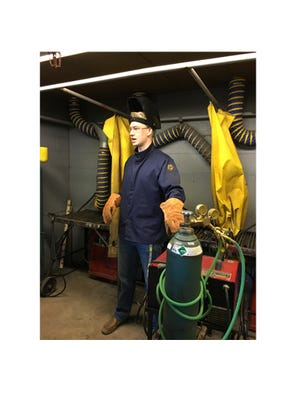 James Mathiowetz, Summer Ag Intern at Sleepy Eye High School, taught welding to a small group of FFA members -- one of the mini hands on courses offered for summer FFA/Ag.