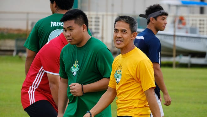 UOG soccer coach Rod Hidalgo works with players in this file photo.