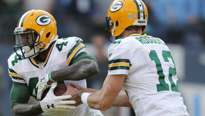 Green Bay Packers' James Starks (44) takes the hand off from Green Bay Packers' Aaron Rodgers (12) Sunday, Nov. 13, 2016, at Nissan Stadium in Nashville, Tenn.