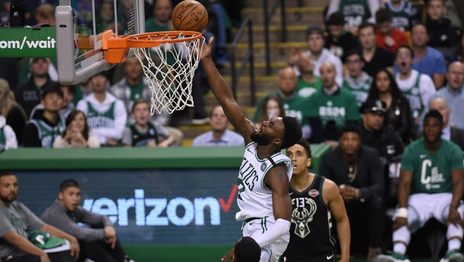 Boston Celtics guard Jaylen Brown (7) lays the ball in the basket while Milwaukee Bucks center John Henson (31) looks on during the first half in game two of the first round of the 2018 NBA Playoffs at TD Garden.