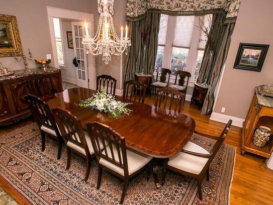 A 100-year-old handwoven Persian rug is the centerpiece