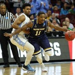 Mar 27, 2016; Philadelphia, PA, USA; Notre Dame Fighting Irish guard Demetrius Jackson (11) drives against North Carolina Tar Heels guard Joel Berry II (2) during the first half in the championship game in the East regional of the NCAA Tournament at Wells Fargo Center. Mandatory Credit: Bill Streicher-USA TODAY Sports