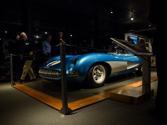 People gather to look at the 1956 Corvette SS on display