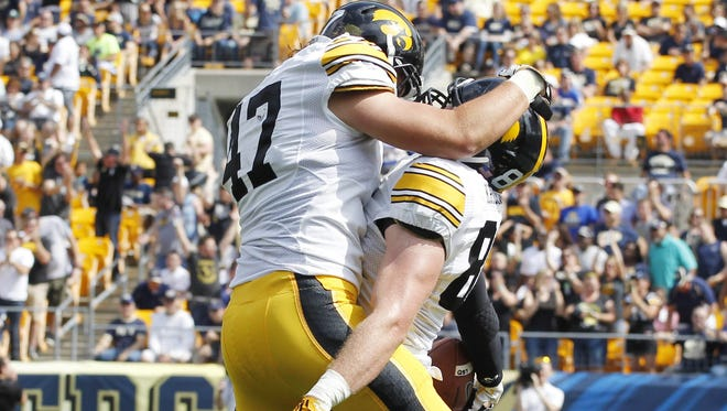 Iowa fullback John Kenny (47) and tight end Henry Krieger Coble celebrate a touchdown against Pittsburgh.