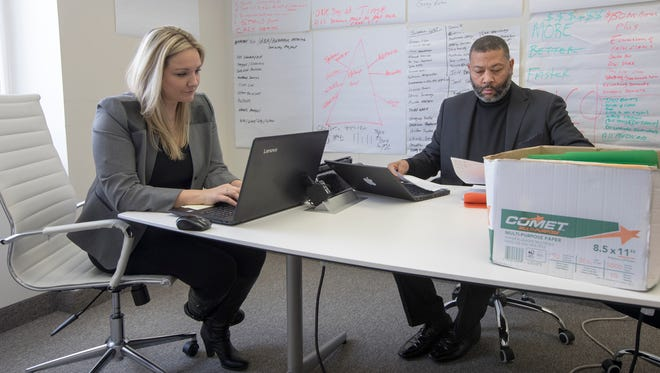Vanessa Pawlak, former chief compliance officer for Centria Healthcare, left, and Curtis Moore, former Centria senior sales executive, at his  office in Southfield on Thursday, Feb. 8, 2018. The former Centria employees have accused company officials of illegal activity and the company has accused them of defamation in a lawsuit filed in Oakland County in December.