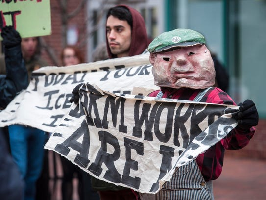 Members of Migrant Justice demonstrate outside the