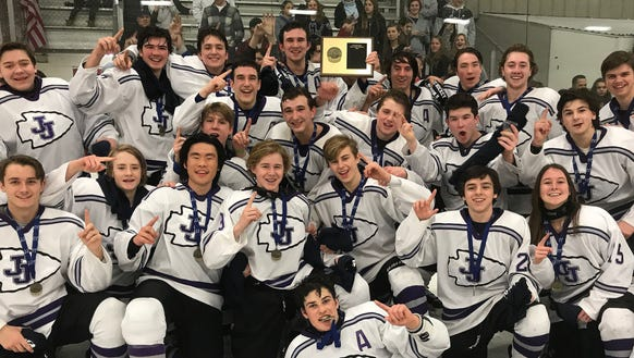 John Jay (CR) players celebrate with the section 1