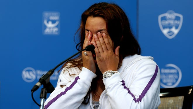 Marion Bartoli of France announces her retirement from professional tennis Wednesday night during the Western & Southern Open.