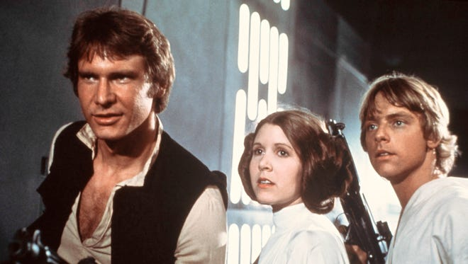 Harrison Ford, Carrie Fisher, and Mark Hamill in 1977's 'Star Wars.' The film's influential cinematographer, Gilbert Taylor, died Aug. 23.
