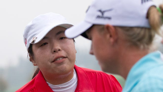 Shanshan Feng of China and Stacy Lewis of the USA.