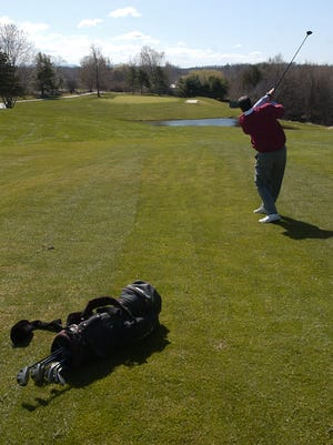 Glory days: A golfer hits from the fairway of the fifth hole at Kwiniaska Golf Club in Shelburne, photographed in mid-April, 2009. The first six holes of the course lie on the west side of Spear Street — a parcel of land under consideration for a housing development.