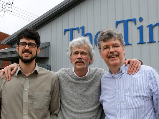 From left: Tom, Art and John Cullen stand outside of