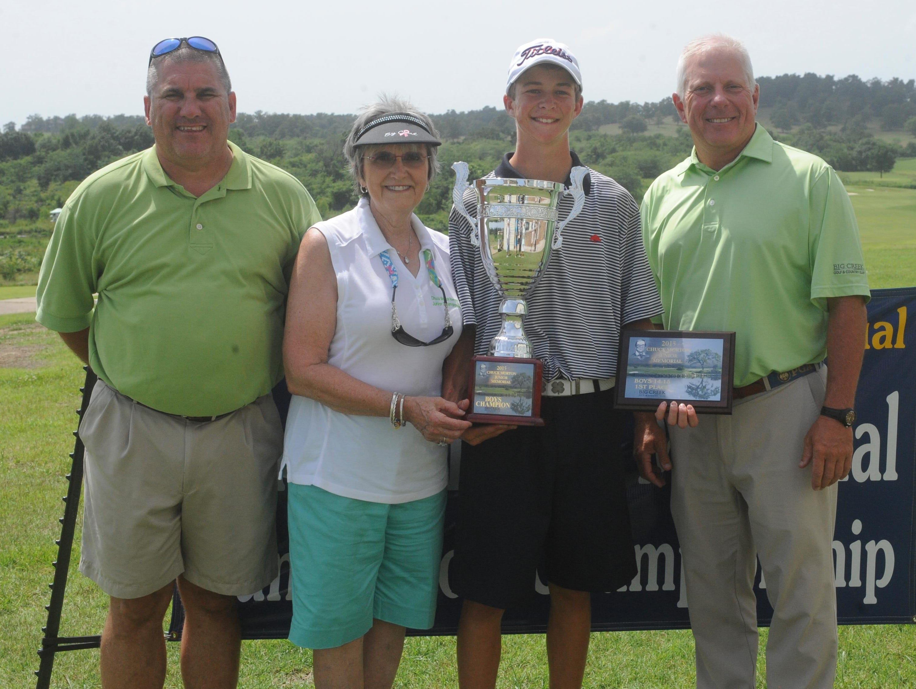 Jonesboro's Wil Gibson, third from left, holds both the overall championship trophy and the 14-15 age division championship trophy after winning the Chuck Morton Memorial Junior Golf Tournament at Big Creek Golf & Country Club. Shown with Gibson are: from left, tournament director Mark Morton, tournament director Beverly Morton, and Big Creek head professional Todd Dunnaway.