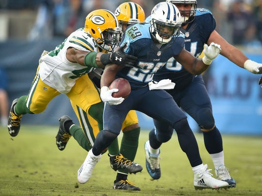 Titans running back DeMarco Murray (29) advances while taking a hit Packers linebacker Joe Thomas (48) from during the second half, Sunday, Nov. 13, 2016, at Nissan Stadium in Nashville, Tenn.