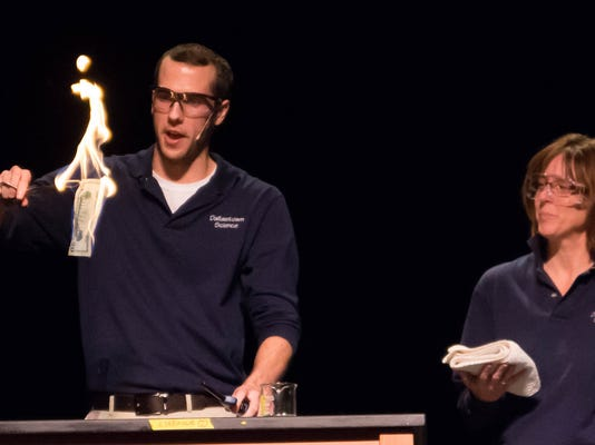 """Dallastown teachers perform science demonstrations, like the """"unburnable money,"""" during the annual Night of Science."""