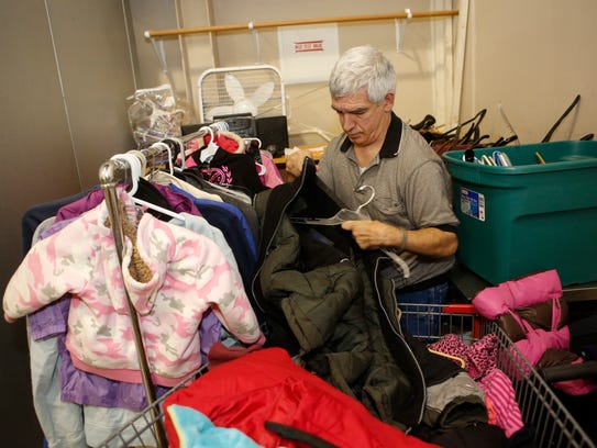 Volunteer Frank Cairo organizes clothing donations