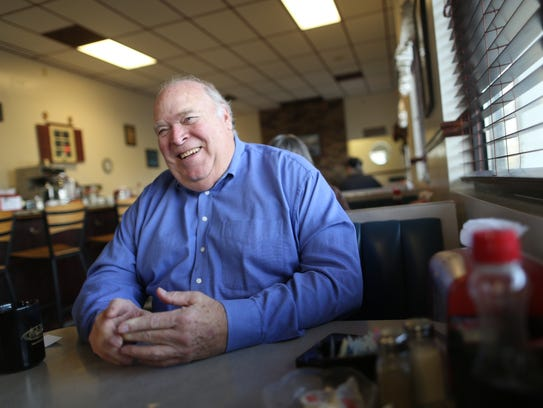 Winchester, Va., resident Larry Sams, 70, eats breakfast