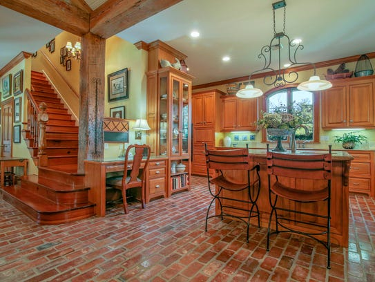 The kitchen and keeping area feature brick floors and