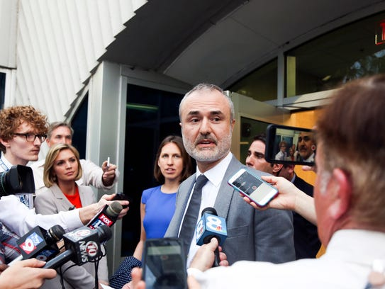Gawker founder Nick Denton speaks to the media on Friday,