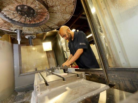 Dave Cruz, a machine operator at Franklin Fibre-Lamitex