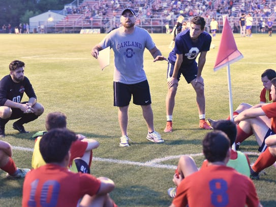 Oakland soccer coach Jeff Porter talks to his troops