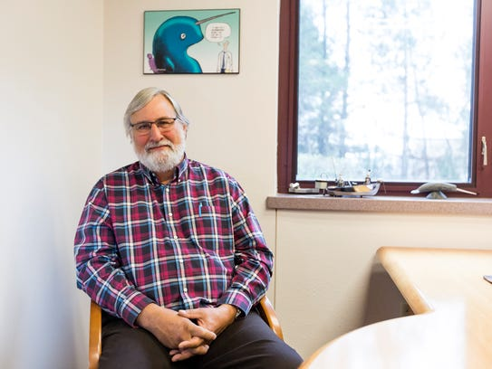 Dr. Fred Eichmiller poses for a portrait in his office